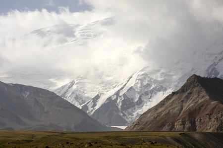 Pamir mountains with peak Lenin, which is shrouded by clouds, Kyrgyzstan