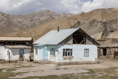 Residential hous of border town Sary-Tash in Kyrgyzstan to neighboring Tajikistan on the Pamir Highway in Central Asia Stock Photo