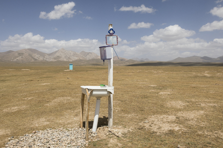 A lone toilet with lavabo at Song Kul lake in Kyrgyzstan
