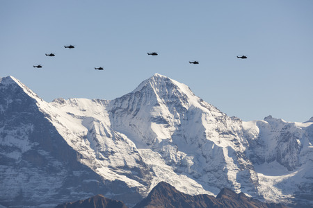 The Swiss Air Force flies with its helicopters a display between the Jungfraujoch and the mountain Jungfrau above the Alps in the Bernese Oberland in Switzerland
