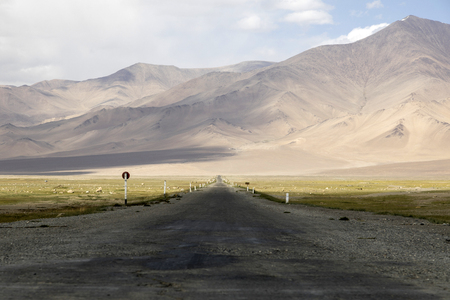 Desert-like landscape along the famous Pamir Highway in Tajikistan