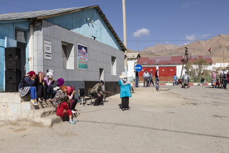Murghab, Tajikistan, August 23 2018: The population is sitting on the street enjoying the beautiful weather in Murghab in the Pamir mountains