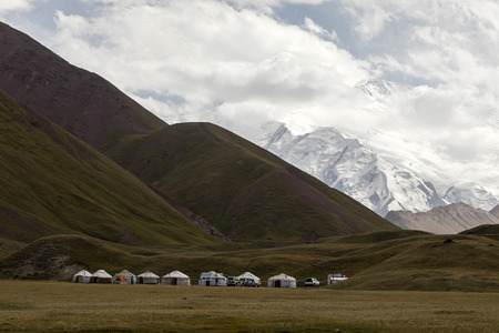 Tulpar, Kyrgyzstan August 21 2018: Yurt Base Camp at Tulpar Lake at the foot of Peak Lenin in Kyrgyzstan