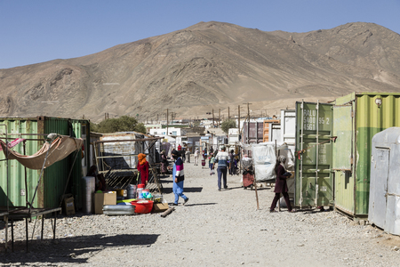 Murghab, Tajikistan, August 23 2018: Market in Murghab on Saturday morning. The sales stands are in old containers Editorial