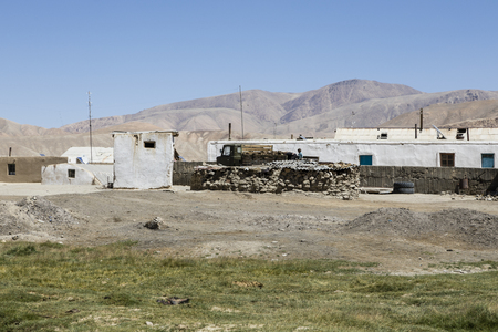 Bulunkul, Tajikistan, August 23 2018: The secluded place Bulunkul with traditional clay and stone houses in the Pamir mountains