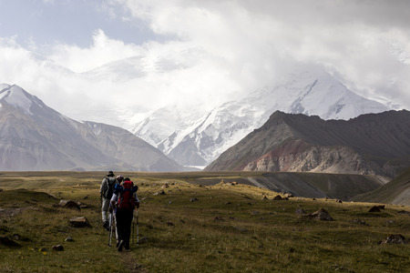 Tulpar, Kyrgyzstan August 21 2018: Tourists walk to base camp at the foot of Peak Lenin in Kyrgyzstan Editorial