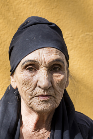 Khorog, Tajikistan August 25 2018: Beautiful old Tajik woman with headscarf and deep facial wrinkles in Khorog, Tajikistan
