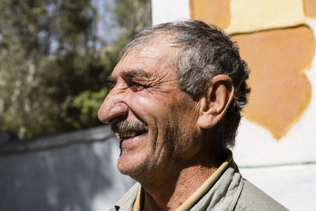 Vrang, Tajikistan August 24 2018: Portrait of an old laughing man in Vrang in the Wakhan valley in Tajikistan