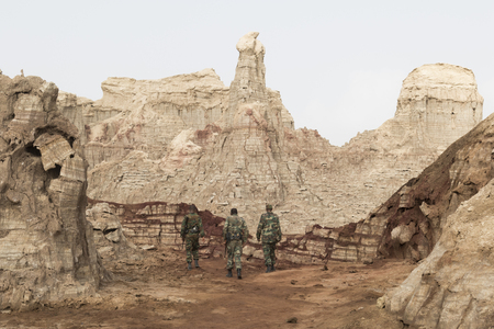 Danakil, Ethiopia, January 22 2015: Three soldiers review the security situation in the Salt Mountains in the Danakil desert