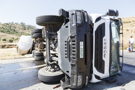 Addis Abeba, Ethiopia, January 15 2015: Accident on a country road with a diesel tanker truck overturned in a curve