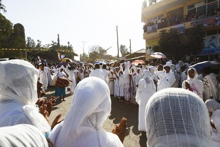 Gonder, Ethiopia, February 18 2015: People dressed in traditional attire celebrate the Timkat festival, the important Ethiopian Orthodox celebration of Epiphany Imagens - 120453714