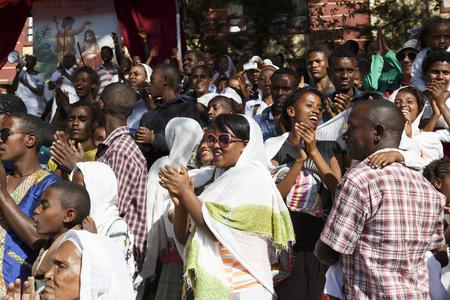 Gonder, Ethiopia, February 18, 2015: Locals celebrate the Timkat festival on a staircase, the important Ethiopian Orthodox celebration of Epiphany Imagens - 120453717