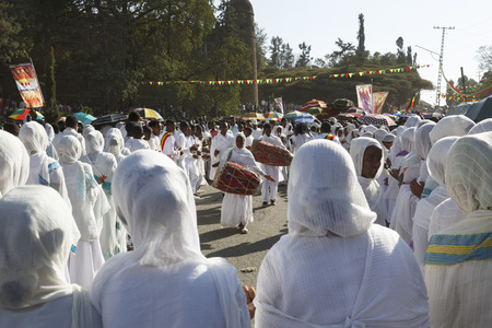 Gonder, Ethiopia, February 18 2015: People dressed in traditional attire celebrate the Timkat festival, the important Ethiopian Orthodox celebration of Epiphany Imagens - 120453722