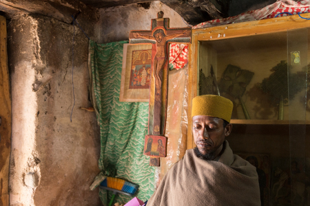 Bahir Dar, Ethiopia, January 22 2015: A monk protects orthodox books in a monastery on a peninsula on lake Tanna