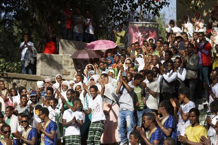 Gonder, Ethiopia, February 18, 2015: Locals celebrate the Timkat festival on a staircase, the important Ethiopian Orthodox celebration of Epiphany Imagens - 120453725