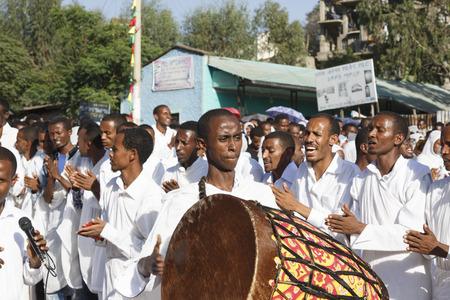 Gonder, Ethiopia, February 18 2015: People dressed in traditional attire celebrate the Timkat festival, the important Ethiopian Orthodox celebration of Epiphany Imagens - 120453747