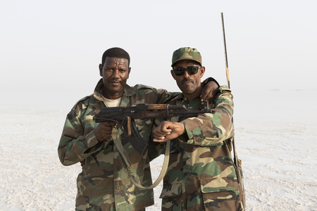 Danakil, Ethiopia, January 22 2015: Two soldiers posing proudly with their guns in the Danakil desert