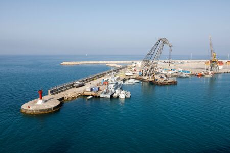 Durres, Albania, July 4 2019: Industrial port in Durres Albania with loading cranes and containers