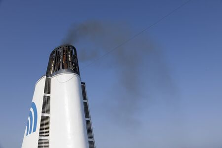Durres, Albania, July 4 2019: Smoking chimney of a passenger ferry in the Mediterranean. Emission of soot particles and polluting exhaust gases Banco de Imagens - 138488118