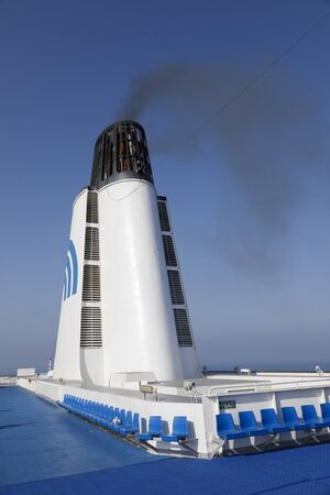 Durres, Albania, July 4 2019: Smoking chimney of a passenger ferry in the Mediterranean. Emission of soot particles and polluting exhaust gases