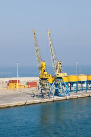 Durres, Albania, July 4 2019: Industrial port in Durres Albania with loading cranes and containers Banco de Imagens - 138556457