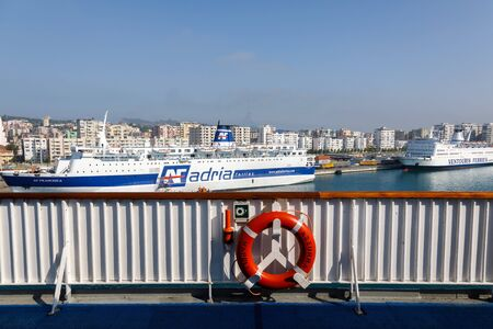 Durres, Albania, July 4 2019: View from a passenger ferry with a lifebuoy in the foreground over the city of Durres with other ferries