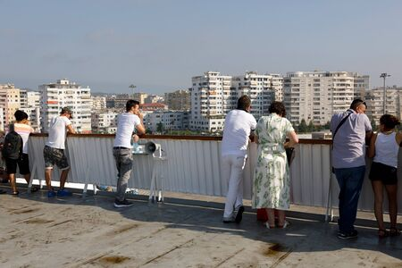 Durres, Albania, July 4 2019: Passengers watch the ferry landing in Durres harbor on the deck