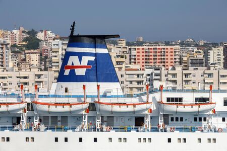 Durres, Albania, July 4 2019: Close up of a chimney of a passenger ferry in the port of Durres with the city in the background