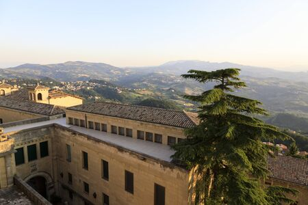 Old town of San Marino with the hilly landscape in the background