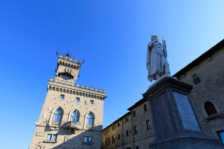 San Marino, San Marino Republic, July 1 2019: Liberty statue and public palace. Palazzo Pubblico is the town hall of the City of San Marino, it is the official Government Building Editorial