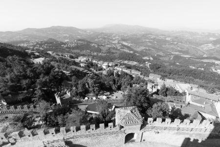 Guaita Castle in San Marino. Exterior of Rocca della Guaita castle. Hilly Landscape of Italy in the background