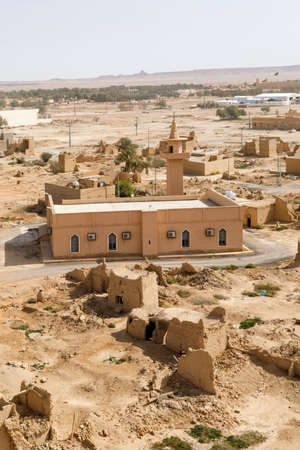 View of the small village Raghba with a mosque in the middle of the desert in Saudi Arabia