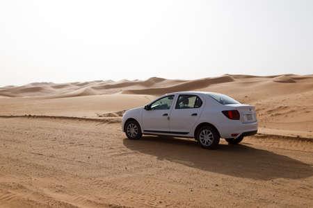 Riyadh, Saudi Arabia, February 16 2020: Typical gravel road with a white car in Saudi Arabia that leads through the desert. Editorial
