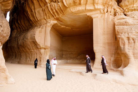 Al Ula, Saudi Arabia, February 19 2020: Tourists inside the Siq of Jabal Ithlib in Al Ula, KSA