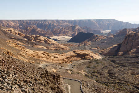 Winding road near Al Ula, which leads up through a dry valley to a viewpoint, Saudi Arabia