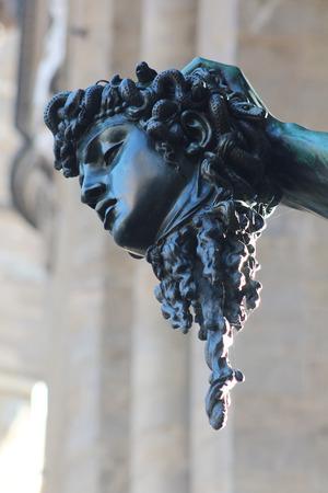 dante alighieri: FLORENCE, ITALY - NOVEMBER, 2015: Dante Alighieri monument, Signoria square, Head of Perseus, Benvenuto Cellini