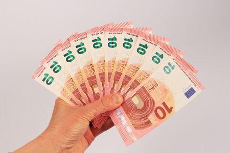 ten euro banknotes in hand