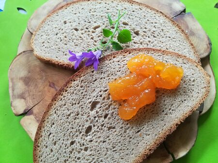 Bread and marmalade with flower Stock Photo