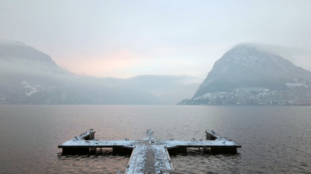 Lake Lugano in winter, concepts of doubt, choice, uncertainty, crossroads