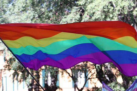 Rainbow flag, international symbol of peace and self-determination movements Archivio Fotografico - 124603684