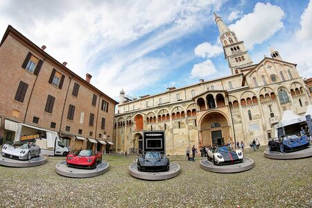 MODENA, ITALY, May 16 2019 - Motor Valley Fest exhibition, Pagani Zonda and the cathedral of Modena Archivio Fotografico - 124582712