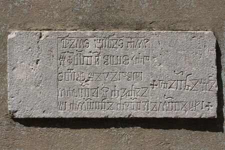 Croatia, Krk island, glagolitic inscriptions in the stone Archivio Fotografico - 127763087