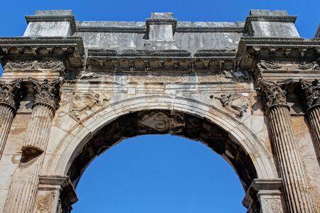 Pula, ancient Sergi monumental arc, ancient Roman city, Istria, Croatia, touristic place Archivio Fotografico - 128379555
