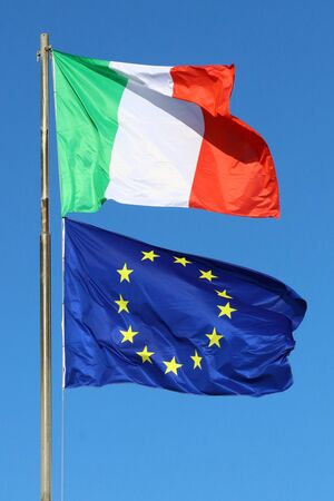 Italy and European Union flags in the wind, European and Italian symbols