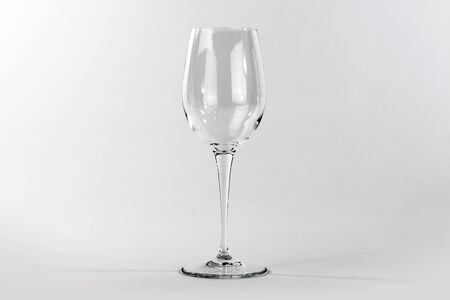 Glass flute in empty glass on white background