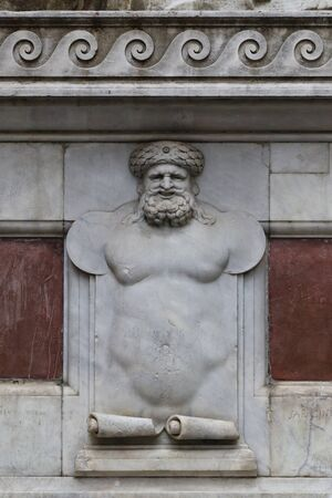 Detail of bas-relief of Arab character, base of the statues in front of the old building, Florence, Italy Archivio Fotografico