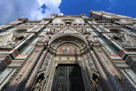 Santa Maria in Fiore facade detail, wide angle shot from below, Florence, Italy
