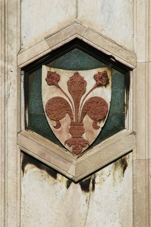 Lily of Florence, historical symbol of the ancient city of Florence, Tuscany, Italy, touristic place, hexagonal detail on the Giotto tower