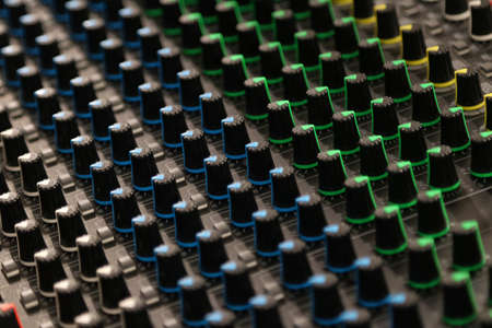 Buttons and knobs to adjust a mixer for music and sound processing Archivio Fotografico