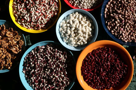Beans of various types in dishes, ingredient for cooking Archivio Fotografico